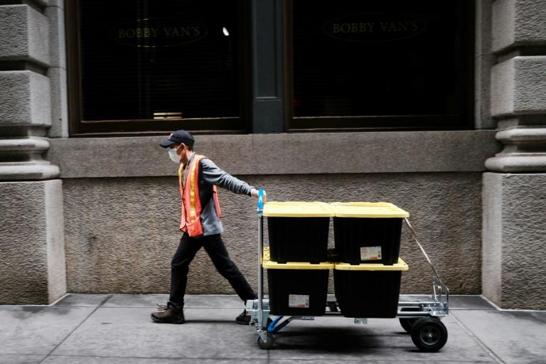Few people are out in New York City, with many of those still on the street delivering food and other essential items