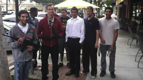 This image provided by the Glendora Police Department shows a group of student filmmakers Friday Aug. 2, 2013 in Los Angeles. The college filmmakers were using fake guns to shoot a robbery scene at a suburban Los Angeles coffee shop when Los Angeles Police officers arrived thinking it was an actual robbery. The students were allowed to keep the fake weapons and weren't facing any charges. They were given a lecture by officers about the dangers they created and went on their way. (AP Photo/Glendora Police Department)