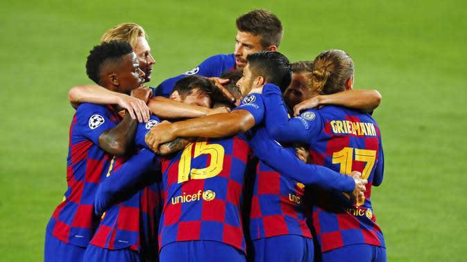 4. Barcelona - Lionel Messi dkk mengamankan tiket perempat final Liga Champions usai menang atas Napoli dengan agregat 4-2. Di babak 8 Besar, Barcelona akan berhadapan dengan tim kuat Bayern Munchen. (AP/Joan Monfort)