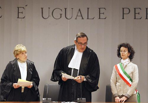 FILE -- In this Thursday, Jan. 30, 2014 file photo, appeals Court Judge Alessandro Nencini, center, reads out the verdict for the murder of British student Meredith Kercher, in Florence, Italy. Defense lawyers for Sollecito, Knox's co-defendant, said Monday, Feb. 3, 2014, they will request disciplinary action against Nencini because of comments the presiding appellate court judge made to Italian media about Sollecito's defense strategy following Thursday's guilty verdict. Nencini was quoted as suggesting that Sollecito's decision not to testify may have worked against him by depriving the defense of a key voice during the proceeding. The defense said the judge's reported comments could form part of its planned appeal of the verdict against their client. (AP Photo/Fabrizio Giovannozzi)