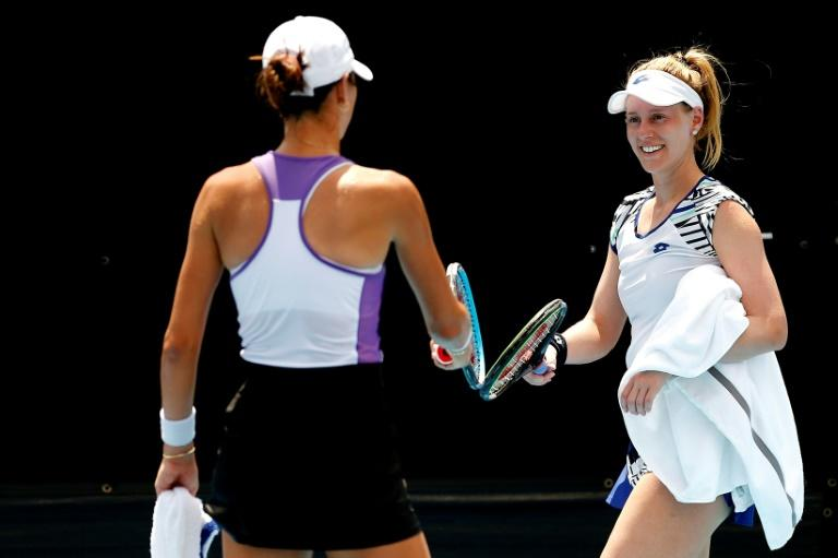 Well played: Ajla Tomljanovic and Alison Riske tap racquets in lieu of a hug as social distancing measures were enforced at the UTR Pro Match Series tennis mini-tournament