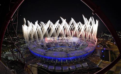 Fireworks ignite over the Olympic Stadium during the Opening Ceremony at the 2012 Summer Olympics, Saturday, July 28, 2012, in London. (AP Photo/Mark J. Terrill)