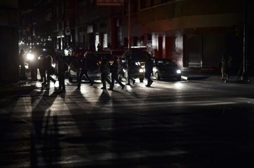 The streets of Caracas go dark in a blackout the government blames on sabotage of hydroelectric power plant