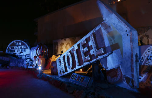 Old motel and casino signs are lit by spot lighting at the Neon Museum in Las Vegas on Friday, May 24, 2013. For the past six months, tourists have had to squint up at the hulking metal forms through the desert sun. On Friday, the Neon Museum unveiled nighttime hours. (AP Photo/Julie Jacobson)