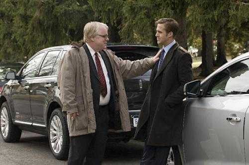 """In this image released by Colombia Pictures, Philip Seymour Hoffman, left, and Ryan Gosling are shown in a scene from """"Ides of March."""" Police say Phillip Seymour Hoffman was found dead in his New York City apartment Sunday, Feb. 2, 2014. He was 46. (AP Photo/Columbia Pictures - Sony, Saeed Adyani, File)"""