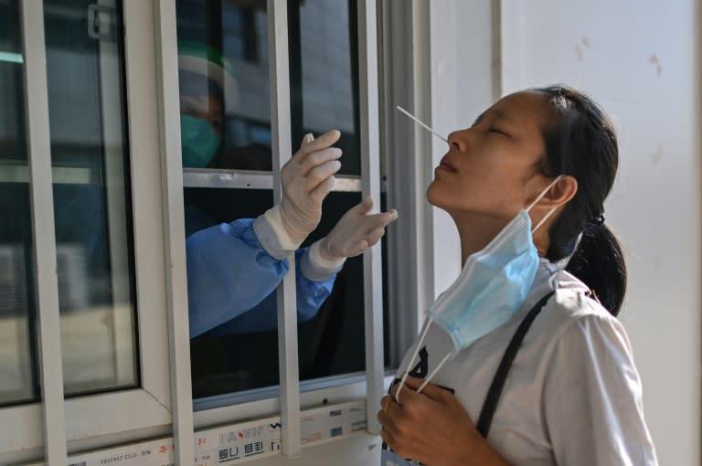 US eases China travel warning, citing virus progress