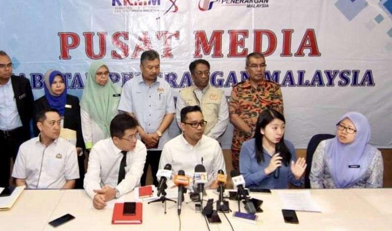Yeo (seated, second from right) speaks to reporters during a media conference at the Pasir Gudang Municipal Council. — Picture by Ben Tan