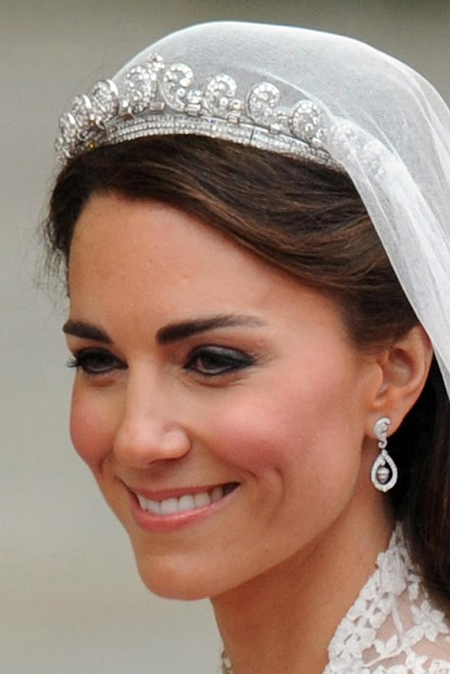 <p>Kate wore the Cartier Halo tiara with her Alexander McQueen bridal gown on her wedding day in 2011. Made by Cartier in 1936, the Halo tiara was an anniversary present from King George VI to the Queen Mother. She passed it down to her daughter the Queen on her 18th birthday. Photo: Getty </p>