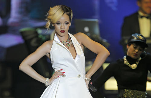 "FILE - In this Wednesday, July 10, 2013 file photo, singer, songwriter Rihanna performs at ""Le Sporting"" in Monaco during her ""Diamonds World Tour"". A British judge has ruled Wednesday July 31, 2013, in favor of the singer Rihanna, who sued retailer Topshop for selling a T-shirt bearing her image without permission. High Court Justice Colin Birss says buyers were likely deceived into buying the shirt under the belief she had authorized its sale. (AP Photo/Lionel Cironneau, File)"