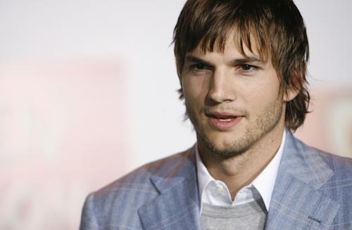 "FILE - Actor Ashton Kutcher poses for photographers at the premiere of ""Open Season"" in Los Angeles, in this Sept. 25, 2006 file photo. An online ad featuring Ashton Kutcher as an Indian man has been pulled offline after it received online criticism. The images and video for Popchips featuring the 34-year-old ""Two and a Half Men"" star in brown make-up portraying a Bollywood producer named Raj who is ""looking for love"" was removed from YouTube and Facebook after it was criticized for being racist. (AP Photo/Matt Sayles)"