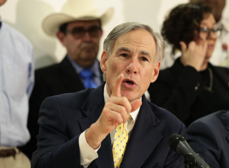 FILE - In this March 16, 2020, file photo, Texas Gov. Greg Abbott is joined by state and city officials as he gives an update on the coronavirus outbreak in San Antonio. A federal appeals court sided Tuesday, April 7, 2020, with Texas in allowing it to ban most abortions while the state is under an emergency order that limits non-essential surgeries during the coronavirus pandemic. (AP Photo/Eric Gay, File)