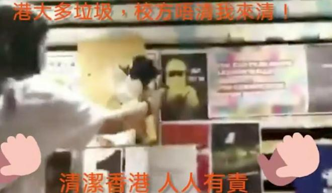A screen capture of a video posted online showing people defacing the wall. Photo: Facebook