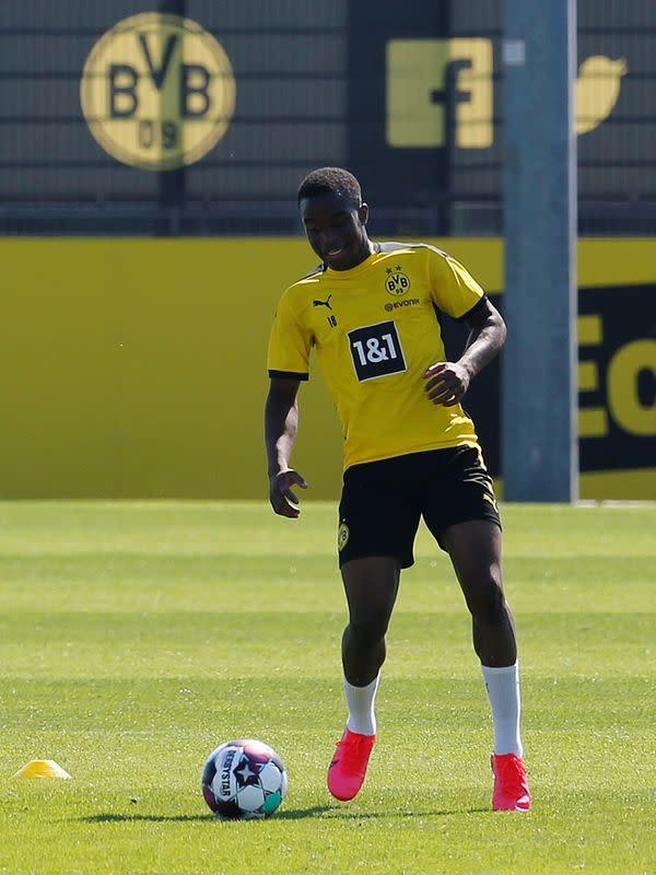 Schalke apologise to Dortmund teenager Moukoko for fan insults