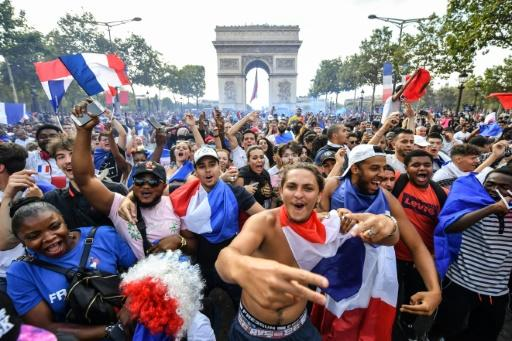 Massive crowds gathered on the Champs Elysees in Paris to celebrate