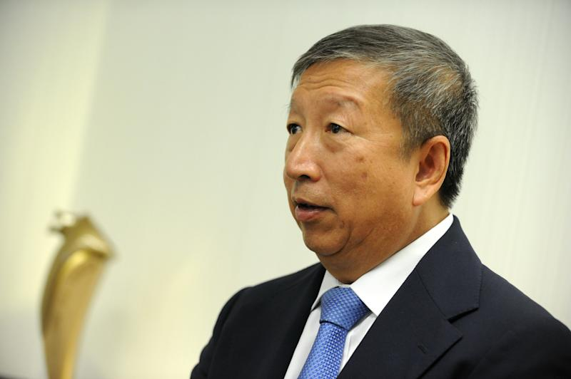 """Would-be Olympics chief Ng Ser Miang speaks to an AFP reporter during an interview at his office in Singapore on August 26, 2013. Ng, one of six men vying to replace International Olympic Committee (IOC) president Jacques Rogge, said on August 26 he was heartened by Russia's promise not to discriminate against homosexuals at next year's Winter Games, adding the event would be """"wonderful"""". AFP PHOTO / ROSLAN RAHMAN (Photo credit should read ROSLAN RAHMAN/AFP via Getty Images)"""