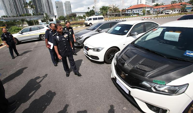 Johor police chief Datuk Ayob Khan Mydin Pitchay inspecting the seized vehicles from a recent raid at the Johor police contingent headquarters in Johor Baru June 29, 2020. — Picture by Ben Tan