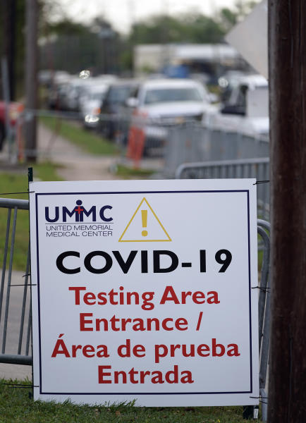 A line of cars stretching over two-miles wait to enter drive-thru testing for COVID-19 at United Memorial Medical Center, Thursday, March 19, 2020, in Houston. For most people, the coronavirus causes only mild or moderate symptoms, such as fever and cough. For some, especially older adults and people with existing health problems, it can cause more severe illness, including pneumonia. (AP Photo/David J. Phillip)