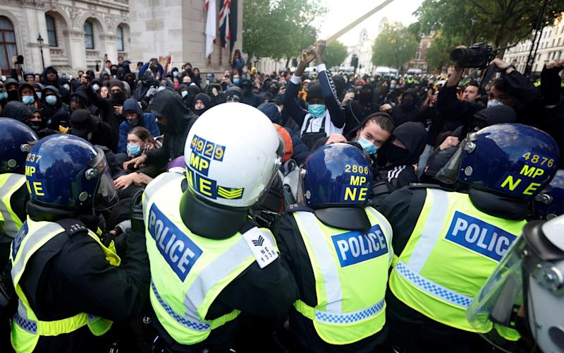 Demonstrators clash with police officers on Whitehall during a Black Lives Matter protest in London June 6