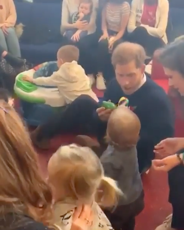 Harry got down on the carpet to play with some junior fans. Photo: Instagram/sussexroyal.