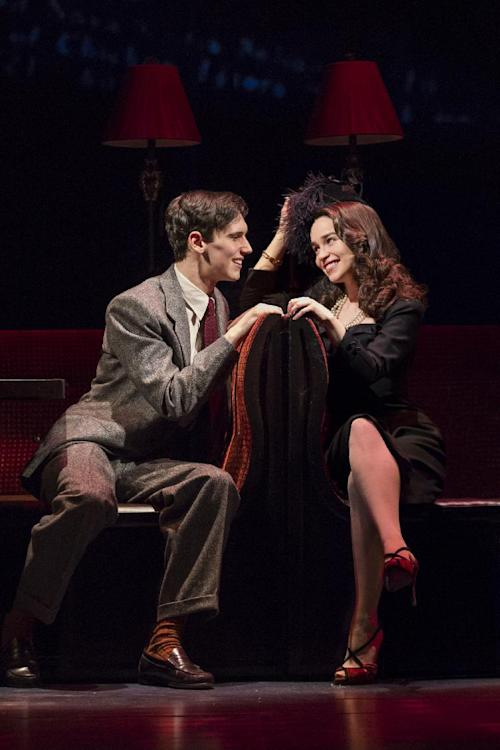 "This theater image released by The O+M Company shows Cory Michael Smith, left, and Emilia Clarke in a scene from ""Breakfast at Tiffany's,"" performing at the Cort Theatre in New York. (AP Photo/The O+M Company, Nathan Johnson Photography)"