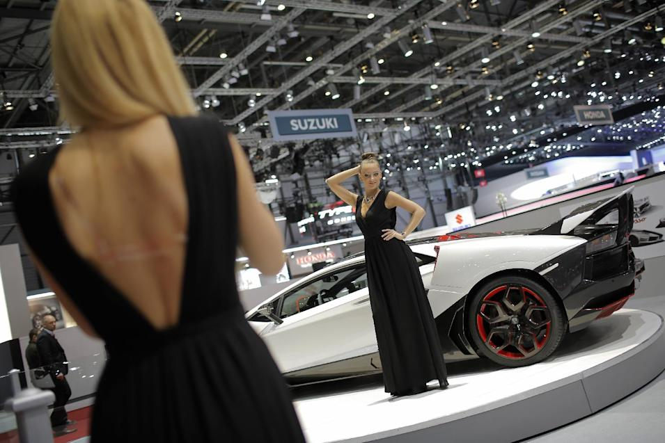 A model poses in front of a Nimrod Performance car during the media day of the 84th Geneva International Motor Show, Switzerland, Tuesday, March 4, 2014. The Motor Show will open its gates to the public from March 6 to 16. (AP Photo/Laurent Cipriani)