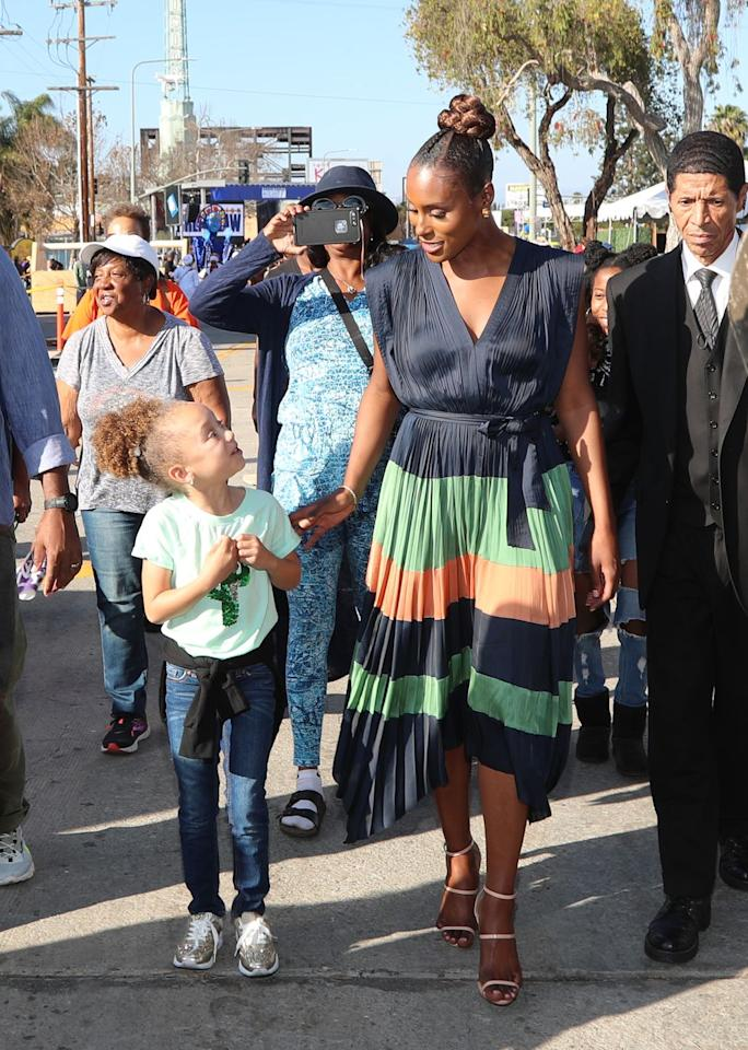 <p>Issa Rae spoke at the groundbreaking event for Destination Crenshaw, an outdoor museum in Los Angeles that celebrates Black culture. She wore a pleated color-blocked dress with beige heeled sandals. </p>