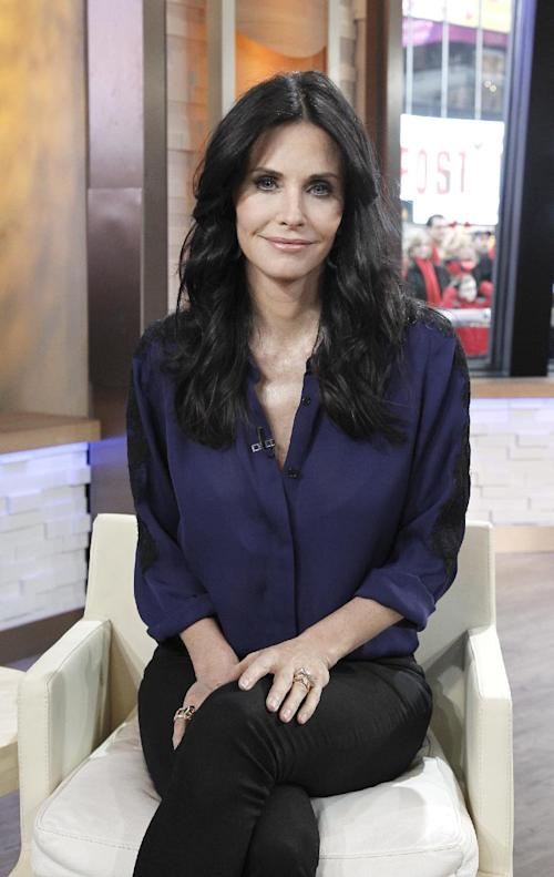 "In this image released by ABC, actress Courteney Cox of ABC's ""Cougar Town"" appears on ""Good Morning America,"" on Tuesday, Feb. 14, 2012. The series makes its third season premiere Tuesday at 8:30p.m. EST on the ABC Television Network. (AP Photo/ABC, Lou Rocco)"