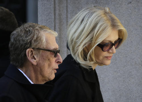 Director Mike Nichols, left, and Diane Sawyer arrive for the funeral of actor Philip Seymour Hoffman at the Church of St. Ignatius Loyola, Friday, Feb. 7, 2014 in New York. Hoffman, 46, was found dead Sunday of an apparent heroin overdose. (AP Photo/Mark Lennihan)