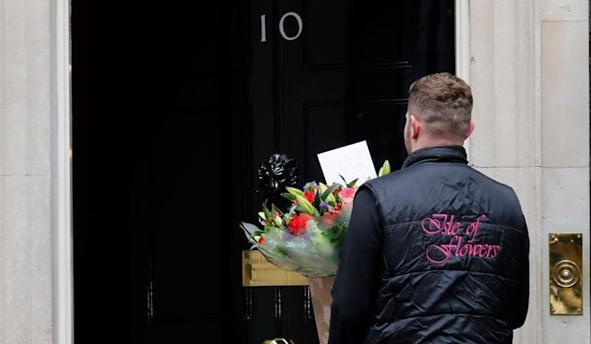 Flowers being delivered to 10 Downing Street. Photo: AFP