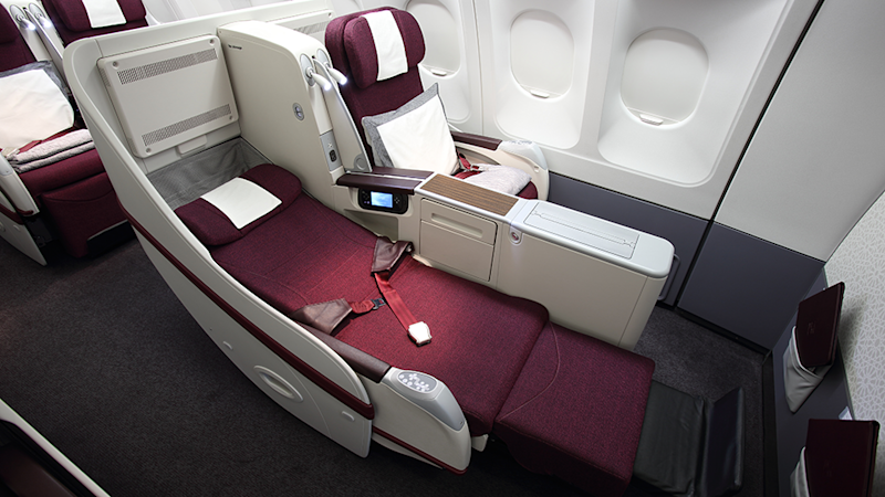 The lie-flat bed which is available in both Q-suite and regular business class. Pictured here is the regular business class option. Photo: Supplied/Qatar Airways