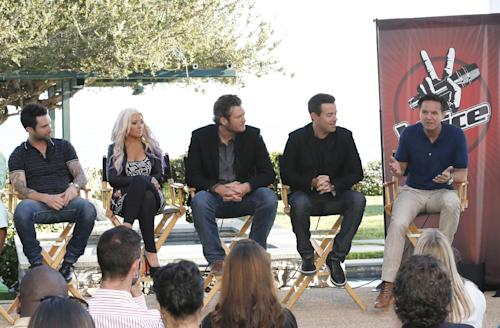 "This Sinday, Aug. 12, 2012 photo released by NBC shows from left, coaches Adam Levine, Christina Aguilera, and Blake Shelton, host Carson Daly and producer Mark Burnett at a news coference for the singing competition series, ""The Voice,"" in Malibu, Calif. Burnett said Sunday that the singing contest will let coaches ""steal"" contestants from each other during the show's ""battle rounds."" The show also will introduce a new ""knockout round"" to slice the number of contestants on each coach's team. The third season of ""The Voice,"" premieres on Sept. 10. (AP Photo/NBC, Chris Haston)"