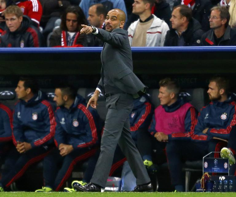 Bayern Munich's coach Guardiola gestures during their Champions League group D first leg soccer match against CSKA Moscow in Munich