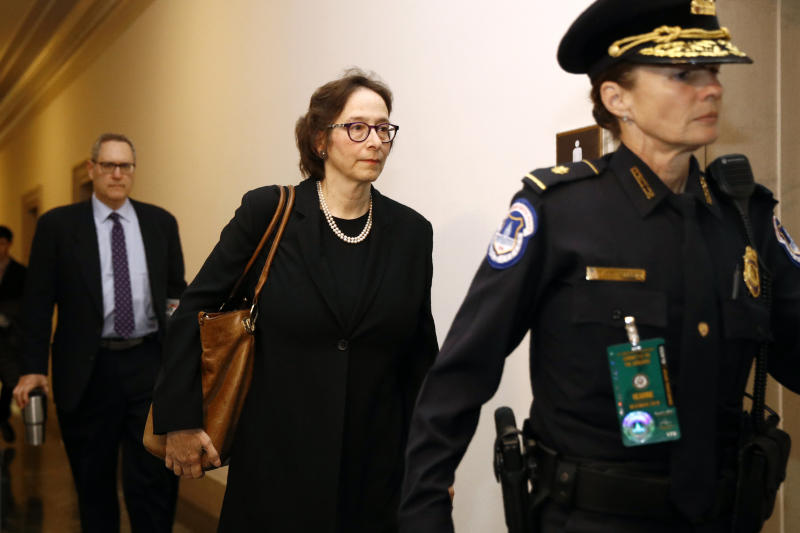 Constitutional law expert, Stanford Law School professor Pamela Karlan, center, arrives to testify at a hearing before the House Judiciary Committee on the constitutional grounds for the impeachment of President Donald Trump, on Capitol Hill in Washington, Wednesday, Dec. 4, 2019. Following Karlan is University of North Carolina Law School professor Michael Gerhardt. (AP Photo/Patrick Semansky)