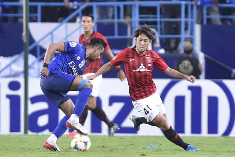 Al Hilal's Salem Al Dawsari, left, fights for the ball with Urawa Reds' Sakine Takahiro during the first leg of the AFC Champions League final soccer match between Al Hilal and Urawa Red at King Fahd stadium in Riyadh, Saudi Arabia, Saturday, Nov. 9, 2019. Al Hilal won 1-0. (AP Photo)