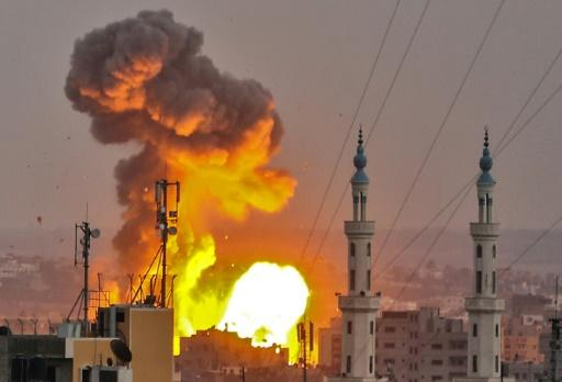 A fireball erupts over Gaza City as Israeli aircraft and tanks hit targets across the territory on July 20, 2018, after a soldier was shot dead on the border