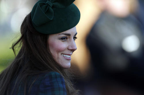 Britain's Duchess of Cambridge talks to people after she and other members of the royal family attended a Christmas Day Service at St. Mary's church on the grounds of Sandringham Estate, the Queen Elizabeth's retreat, in Norfolk, England, Wednesday, Dec. 25, 2013. (AP Photo/Lefteris Pitarakis)