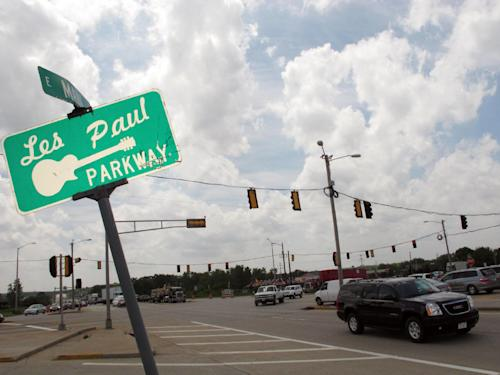 "This May 30, 2103 photo shows a Waukesha, Wis. road named after Les Paul, the renown musician also known for his innovations on the solid body electric guitar and multitrack recording. The Waukesha County Museum is opening a permanent exhibit on June 9, 2013 about the Waukesha native called ""Les Paul: The Wizard of Waukesha."" (AP Photo/Carrie Antlfinger)"