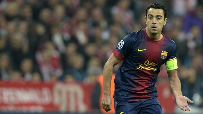 2. Xavi Hernandez - Xavi merupakan salah satu gelandang terbaik yang pernah dimiliki Barcelona. Ia merasakan trebele winner saat membawa Barcelona meraih juara Liga Champions, Spanish Champion, Spanish Cup pada 2009 dan 2015. (AFP/Christof Stache)
