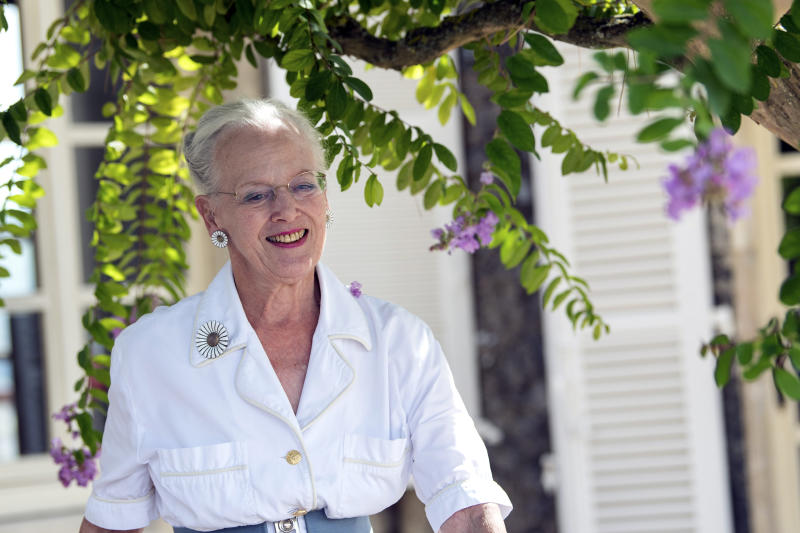 """Denmark's Queen Margrethe arrives for a press conference at the in her Chateau de Caix residence near Cahors, southwestern France, Thursday, Aug.16, 2018. In her first public comments since Henrik died Feb. 13 at age 83, Margrethe says """"it's healthy to be busy,"""" adding """"things go pretty well."""" (AP Photo/Fred Lancelot)"""