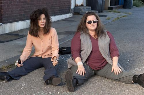 """This film publicity image released by 20th Century Fox shows Sandra Bullock as FBI Special Agent Sarah Ashburn, left, and Melissa McCarthy as Boston Detective Shannon Mullins in a scene from """"The Heat."""" (AP Photo/20th Century Fox, Gemma La Mana)"""