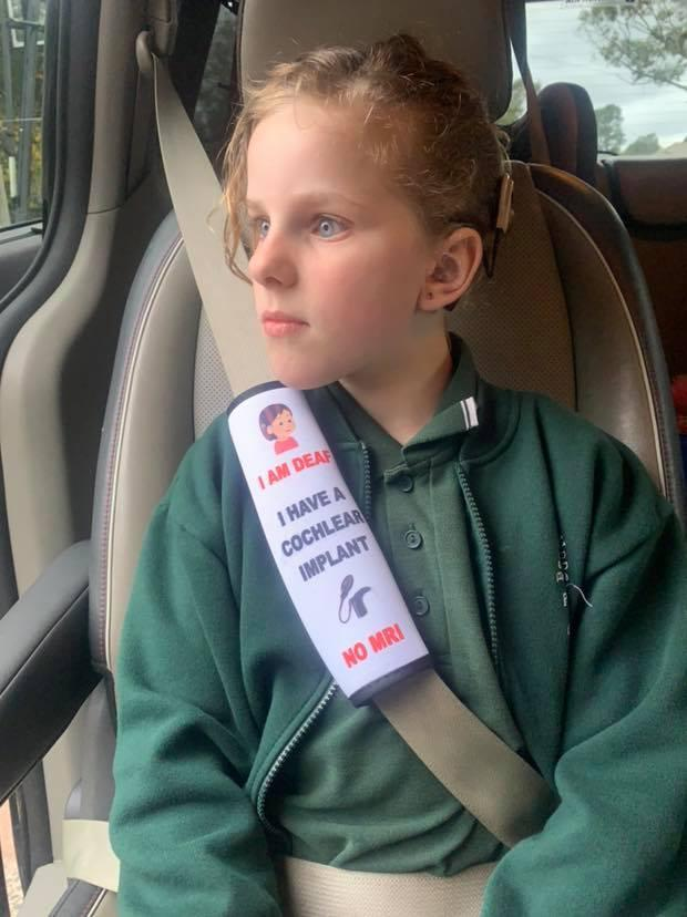 Natalie Bell's daughter Shae with the seatbelt cover she made for her. Source: Facebook / Personalised by Nat