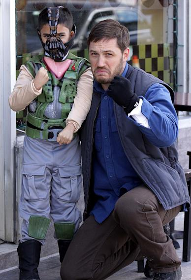 Tom Hardy posing with a fan dressed as Bane at the 'Animal Rescue' set in NYC