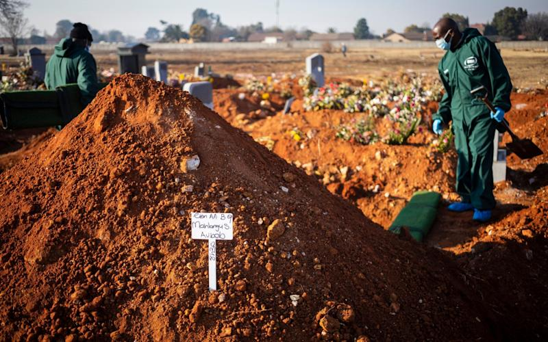 Undertakers David Molofo and Steven Ntuli prepare the graveside before the funeral of an elderly Covid-19 Coronavirus victim at a graveyard near Katlehong township in Johannesburg, South Africa, 24 July 2020 - Photo by KIM LUDBROOK/EPA-EFE/Shutterstock