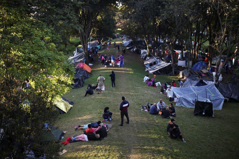 Hundreds of Venezuelans camp in northern Bogota, await return home