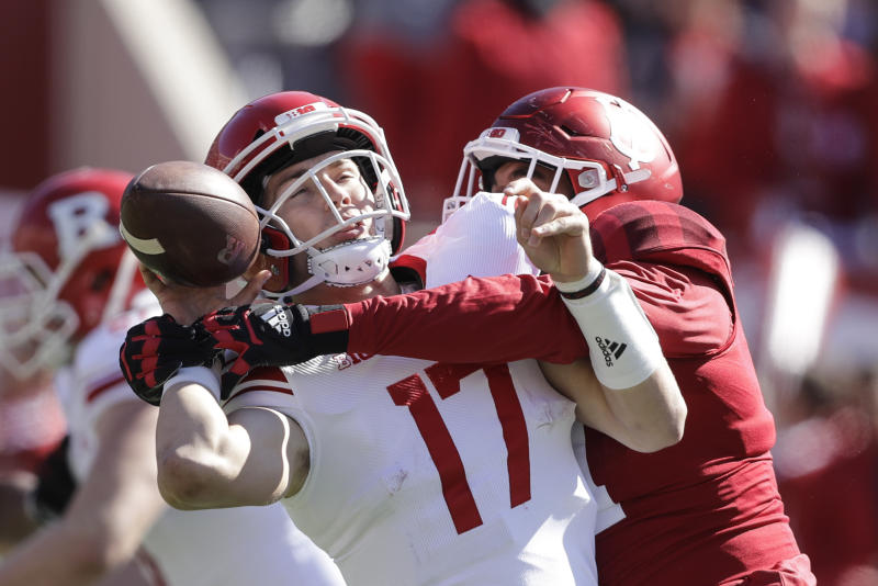 Rutgers quarterback Johnny Langan (17) fumbles as he is hit by Indiana defensive lineman Demarcus Elliott (94) during the first half of an NCAA college football game, Saturday, Oct. 12, 2019, in Bloomington, Ind. (AP Photo/Darron Cummings)