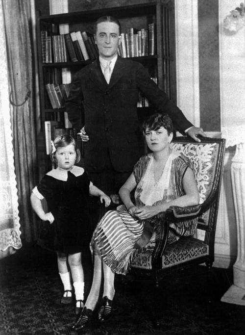 """FILE - This is a 1926 file photo of American author F. Scott Fitzgerald and his wife, Zelda, and daughter, Scotty, in their Paris apartment. Fitzgerald lived in Paris as an expatriate during part of the period he christened """"the Jazz Age."""" Fitzgerald is back on the big-screen with Leonardo DiCaprio and director Baz Luhrmann's """"The Great Gatsby,"""" a story adapted for film and television more than half a dozen times since the silent-movie era, when it was published to scant sales in 1925. (AP Photo/File)"""