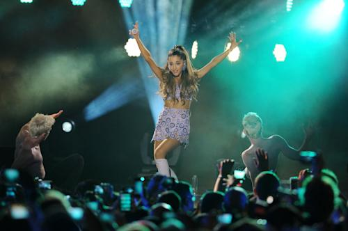 "FILE - In this June 27, 2014 file photo, Ariana Grande performs at the iHeartRadio Ultimate Pool Party at Fontainebleau's BleauLive at Fontainebleau Miami Beach in Miami Beach. Grande is having a breakthrough in music with the multiplatinum hit ""Problem,"" which is spending its 13th week in the top 10 on the Billboard Hot 100 chart. The song features rapper Iggy Azalea and is from Grande's sophomore album, ""My Everything,"" to be released Aug. 25, 2014. (Photo Jeff Daly/Invision/AP)"