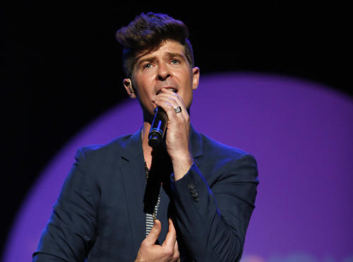 """FILE - This Sept. 15, 2012 file photo released by Point Foundation shows Robin Thicke performing at """"Voices On Point"""" Concert & Gala in Los Angeles. Thisck's """"Blurred Lines,"""" featuring T.I. & Pharrell was the top selling song on iTunes for the week ending June 17, 2013. (AP Photo/Point Foundation, Colin Young-Wolff)"""