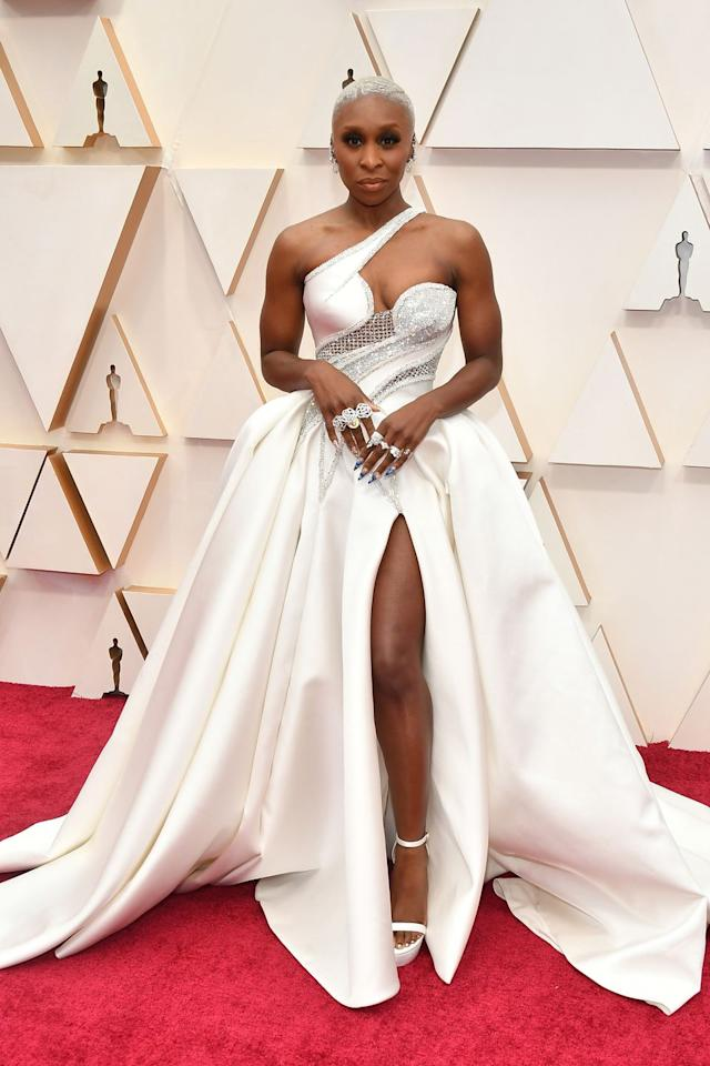 <p>Who: Cynthia Erivo</p><p>When: February 9, 2020</p><p>Wearing: Atelier Versace</p><p>Why: This is how you modernize the ball gown at the Oscars. Cynthia Erivo traded in the cupcake silhouette for a refreshing take on Marie Antoinette panniers, then drowned herself in bling. </p>