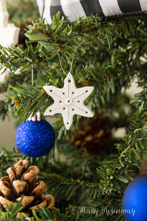 """<p>Roll out polymer clay and cut it out with snowflake-shaped cookie cutters to create these ornaments. Get creative with the details, drawing in designs with toothpicks or pressing on textures with various fabrics. Make sure to poke a hole before baking to run a wire or string through later for hanging.</p><p><em><a href=""""https://www.notjustahousewife.net/easy-clay-snowflake-ornaments/"""" target=""""_blank"""">Get the tutorial at Not Just a Housewife</a></em><br></p>"""